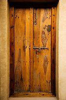 Dubai.  Wooden door at Bab al Shams desert resort.