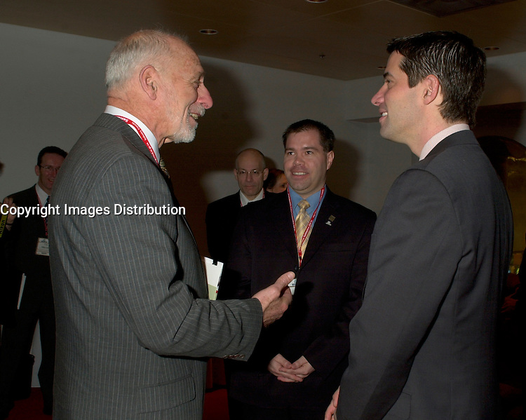 March 19 2003, Montreal, Quebec, Canada<br /> <br />  Andre Boisclair, Quebec's Environment Minister (R) talk with<br /> David Anderson ,Canada's  Environment Minister, (L)  before  the  opening plenary session of Americana ;  a 3 days conference and  trade show on environment and waste management organized by Reseau Environnement, March 19, 2003 in Montreal, Canada.<br /> <br /> Mandatory Credit: Photo by Pierre Roussel- Images Distribution. (©) Copyright 2003 by Pierre Roussel <br /> <br /> NOTE : <br />  Nikon D-1 jpeg opened with Qimage icc profile, saved in Adobe 1998 RGB<br /> .Uncompressed  Original  size  file availble on request.