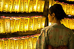 A visitor dressed in traditional Japanese clothing enjoys the display of lanterns during the annual ''Mitama Festival'' at Yasukuni Shrine on July, 13, 2015, Tokyo, Japan. Over 30,000 lanterns line the entrance to the shrine to help spirits find their way during the annual celebration for the spirits of ancestors. The festival is held from July 13th to 16th. (Photo by Rodrigo Reyes Marin/AFLO)