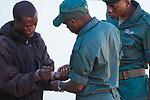 Anti-poaching scouts with poacher, Kafue National Park, Zambia