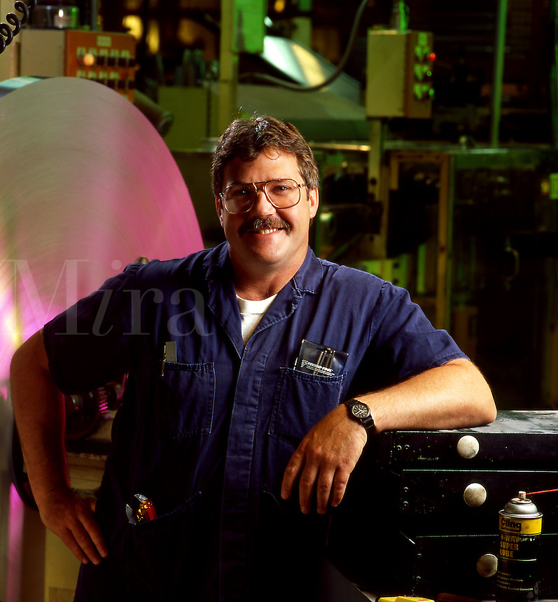 Smiling portrait of a machine operator.