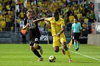 19th September  2021; Angers, Pays de la Loire, France; French League 1 football Angers versus Nantes;  MANCEAU Vincent of Angers  goes past Randal KOLO MUANI of Nantes