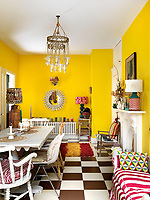The kitchen/dining room is painted a wonderful daffodil yellow and features strong patterns and textures