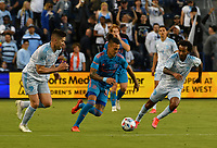 KANSAS CITY, KS - MAY 29: Andreu Fontas #3 and Gianluca Busio #10 of Sporting KC try to keep pace with Maximiliano Urruti #37 of Houston Dynamo FC during a game between Houston Dynamo and Sporting Kansas City at Children's Mercy Park on May 29, 2021 in Kansas City, Kansas.