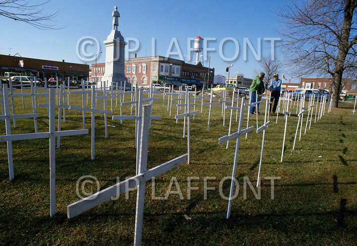 Corydon, IA. March 4th 1985. <br /> As a sign of protest, farmers plant white crosses that represent the number of farms that went under during the crisis.