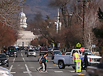 A crossing guard works on King Street in Carson City, Nev., on Thursday, Feb. 19, 2015. <br /> Photo by Cathleen Allison