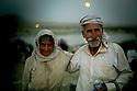 Iraq 2014   August 10, a Yezidi couple , exhausted, arriving in Kurdistan after crossing Pesh Kabur's bridge <br /> <br /> Irak 2014 10 aout, exténués, un couple de Yezidis venant de franchir le pont de Pesh Kabur arrivent au Kurdistan irakien.<br /> <br /> عیراق 2014 ، 10 ی ئاگوست، ژن و مردی ئیزه دی ماندوو ، پردی پیش کابووریان دا هه ر ئیستا تیپه رینه وه و گه یشتوته نه وه کوردستانی عیراق