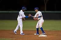 AZL Dodgers infielders Albert Suarez (56) and Kenneth Betancourt (3) celebrate a victory after an Arizona League game against the AZL White Sox at Camelback Ranch on July 3, 2018 in Glendale, Arizona. The AZL Dodgers defeated the AZL White Sox by a score of 10-5. (Zachary Lucy/Four Seam Images)