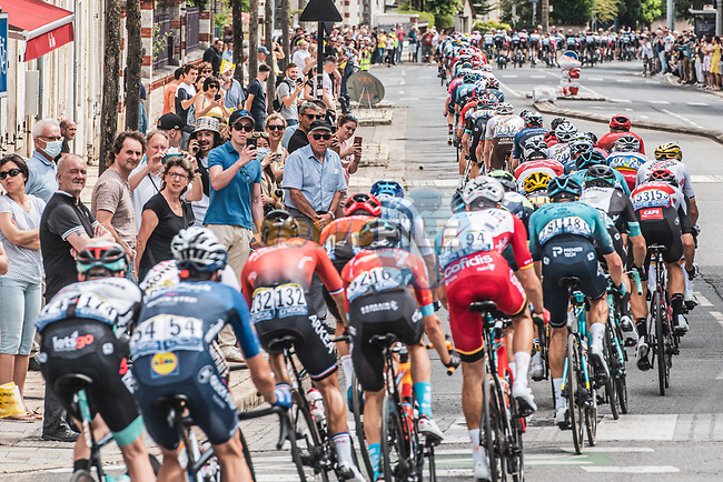 The peloton pass through Bourges during Stage 7 of the 2021 Tour de France, running 249.1km from Vierzon to Le Creusot, France. 2nd July 2021.  <br /> Picture: A.S.O./Charly Lopez | Cyclefile<br /> <br /> All photos usage must carry mandatory copyright credit (© Cyclefile | A.S.O./Charly Lopez)