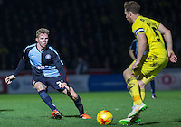 Jason McCarthy of Wycombe Wanderers closes down a player during the Sky Bet League 2 match between Wycombe Wanderers and Oxford United at Adams Park, High Wycombe, England on 19 December 2015. Photo by Andy Rowland.