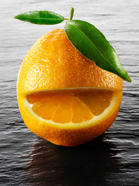 Wole oranges with a smiley face