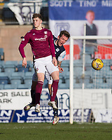 13th March 2021; Dens Park, Dundee, Scotland; Scottish Championship Football, Dundee FC versus Arbroath; Lee Ashcroft of Dundee heads clear from from Jack Hamilton of Arbroath