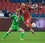 Arjen Robben of Bayern Munich and Jan Polak of VfL Wolfsburg in action during a friendly match as part of the Audi Football Summit 2012 on July 26, 2012 at the Guangdong Olympic Sports Center in Guangzhou, China. Photo by Victor Fraile / The Power of Sport Images