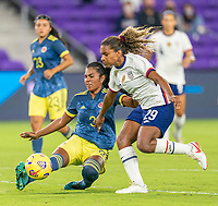 ORLANDO, FL - JANUARY 22: Daniela Arias #3 of Colombia defends Catarina Macario #29 of the USWNT during a game between Colombia and USWNT at Exploria stadium on January 22, 2021 in Orlando, Florida.