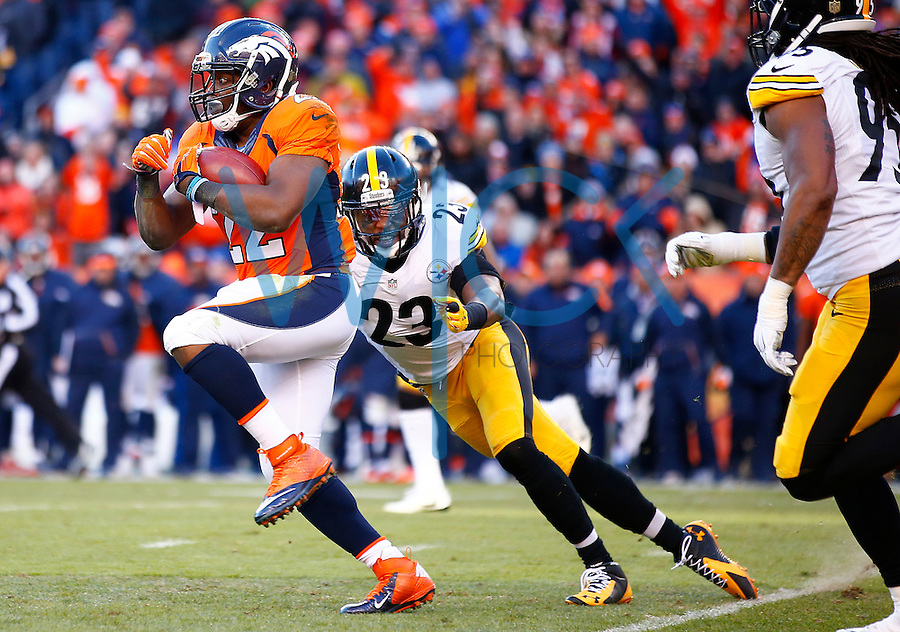 C.J. Anderson #22 of the Denver Broncos carries the ball past William Gay #22 of the Pittsburgh Steelers during the AFC Divisional Round Playoff game at Sports Authority Field at Mile High on January 17, 2016 in Denver, Colorado. (Photo by Jared Wickerham/DKPittsburghSports)