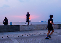 General life and environs in the Malate, Manila area and Manila Bay, Philippines. Sunset, Photographer at sunset.