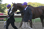 September 20, 2014: California Chrome, led by Willie Delgado (left) and Raul Rodriguez, leaves the track after his defeat in the Grade II Pennsylvania Derby at Parx Racing in Bensalem, PA.  Joan Fairman Kanes/ESW/CSM