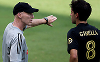 LOS ANGELES, CA - AUGUST 22: Bob Bradley head coach of Los Angeles Football Club has a few words with Francisco Ginella #8 during a game between Los Angeles Galaxy and Los Angeles FC at Banc of California Stadium on August 22, 2020 in Los Angeles, California.
