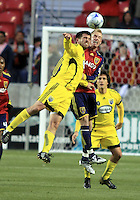 Jason Garey (left) goes up for the header against Nat Borchers (center) along with Guillermo Barros Schelotto (right) in the Columbus Crew vs Real Salt Lake 1-4 RSL win at Rio Tinto Stadium in Sandy, Utah on April 2, 2009.