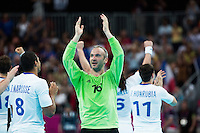 08 AUG 2012 - LONDON, GBR - Thierry Omeyer (FRA) of France (centre in green) celebrates France winning the men's London 2012 Olympic Games quarter final match against Spain at the Basketball Arena in the Olympic Park, in Stratford, London, Great Britain .(PHOTO (C) 2012 NIGEL FARROW)