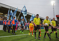 Referee Gavin Ward leads out the teams with his Assistants during the Capital One Cup match between Wycombe Wanderers and Fulham at Adams Park, High Wycombe, England on 11 August 2015. Photo by Andy Rowland.