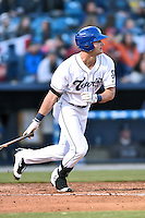 Asheville Tourists left fielder Sam Hilliard (25) swings at a pitch during a game against the Rome Braves at McCormick Field on April 14, 2016 in Asheville, North Carolina. The Braves defeated the Tourists 4-3. (Tony Farlow/Four Seam Images)