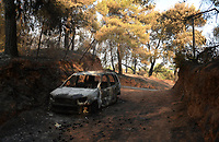 Pictured: A burned out car in the area.<br />