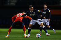 23rd February 2021; Kenilworth Road, Luton, Bedfordshire, England; English Football League Championship Football, Luton Town versus Millwall; Mason Bennett of Millwall takes on Thomas Ince of Luton Town