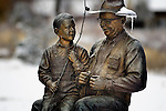 Bronze statue of Vern Golen and small boy going fishing along the St. Vrain Greenway trail in Longmont, CO