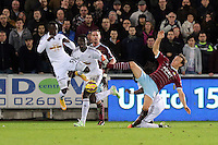Pictured: Modou Barrow of Swansea (L) against Mark Noble of West Ham (R) Saturday 10 January 2015<br /> Re: Barclays Premier League, Swansea City FC v West Ham United at the Liberty Stadium, south Wales, UK