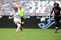 Conor Gallagher of Swansea City has a shot during the Sky Bet Championship match between Swansea City and Luton Town at the Liberty Stadium in Swansea, Wales, UK. Saturday 27 June 2020.