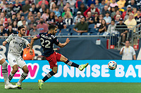 FOXBOROUGH, MA - JULY 25: Carles Gil #22 of New England Revolution takes a shot during a game between CF Montreal and New England Revolution at Gillette Stadium on July 25, 2021 in Foxborough, Massachusetts.