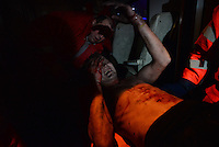 An injured  demonstrator on a stretcher is being carried inside the   ambulance  during the  violent protest against new draconian law to ban protestsacross the country.  Kiev. Ukraine