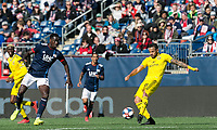 Foxborough, Massachusetts - March 9, 2019: First half action. In a Major League Soccer (MLS) match, New England Revolution (blue/white) vs Columbus  Crew (yellow), at Gillette Stadium.