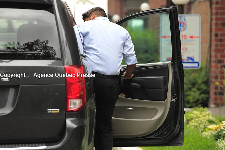 Descente de l'UPAC et de la SQ, <br /> le 30 Juillet 2015,<br />  a la residence de Bernard Trepanier<br /> <br /> <br /> PHOTO :  Agence Quebec Presse