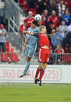 Sporting KC defender Matt Besler #5 and Toronto FC forward Nick Soolsma #18 in action during an MLS game between Sporting Kansas City and the Toronto FC at BMO Field in Toronto on June 4, 2011..The game ended in a 0-0 draw...