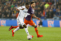 (L-R) Joel Asoro of Swansea City challenged by Kyle Walker of Manchester City during the Emirates FA Cup match between Swansea City and Manchester City at the Liberty Stadium, Swansea, Wales, UK. Saturday 16 March 2019