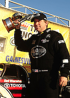 Mar. 13, 2011; Gainesville, FL, USA; NHRA top fuel dragster driver Del Worsham celebrates after winning the Gatornationals at Gainesville Raceway. Mandatory Credit: Mark J. Rebilas-