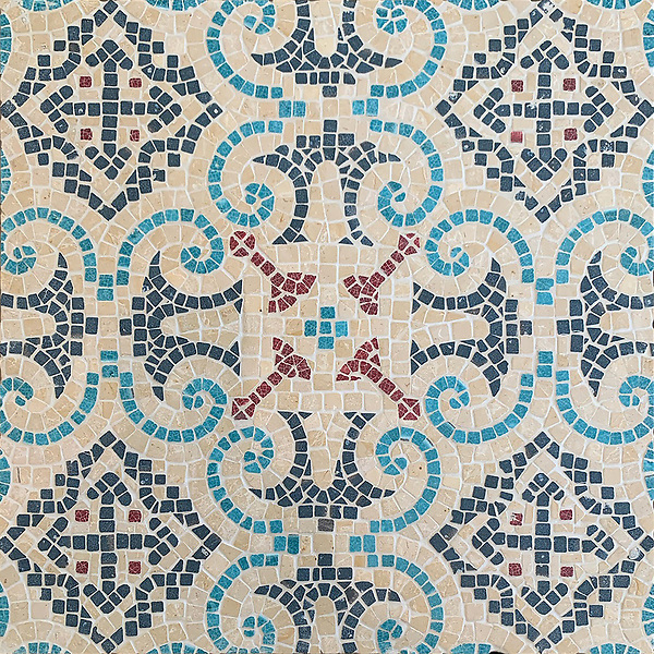 Palma, a hand-cut stone mosaic, shown in tumbled Lagos Gold, Zinnia Basalto, Orchid Basalto, and Aloe Basalto, is part of the Miraflores Collection by Paul Schatz for New Ravenna.