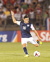 USMNT midfielder Jose Torres (16) passes the ball.  In CONCACAF Gold Cup Group Stage, the U.S. Men's National Team (USMNT) (blue/white) defeated Costa Rica (red/blue), 1-0, at Rentschler Field, East Hartford, CT on July 16, 2013.