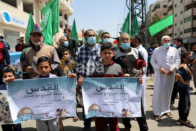 Supporters of the Hamas movement take part in a rally against the decision of the Palestinian authorities president to delay the legislative and presidential polls scheduled for May 22 and July 31, respectively, in Gaza City on April 30, 2021. - Palestinian president Mahmud Abbas announced today that elections are being postponed until Israel guarantees voting can take place in annexed east Jerusalem, further delaying polls in a society which last voted in 2006. Photo by Mahmoud Nasser