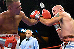 """The """"Reyes"""" sticker on Bronco McKart 's left glove suddenly comes unglued and fly in the air during his 12 rounds NABF Middleweight Title  against Kelly Pavlik at the Mohegan Sun Arena on 07.27.06. Pavlik won by a 6th round knock out."""