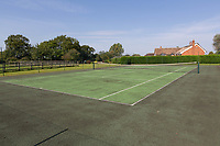BNPS.co.uk (01202 558833)<br /> Pic: Savills/BNPS<br /> <br /> Pictured: The tennis court beside the house.<br /> <br /> A historic thatched home where Cromwell's army stayed during the English Civil War is on the market for £1.6m.<br /> <br /> The Barracks, so-named for its links with Cromwell more than 370 years ago, has spectacular country views and is in one of Cheshire's most popular areas.<br /> <br /> The five-bedroom property just outside the picturesque village of Bunbury is a far cry from how it would have looked in Cromwell's time, having been extended over the years.<br /> <br /> It was used in the 17th century by Cromwell's armies during the siege of Beeston Castle - two miles away. The castle's location made it valuable to both the royalists and parliamentarians.