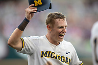 Michigan Wolverines first baseman Jimmy Kerr (15) celebrates scoring a run during Game 1 of the NCAA College World Series against the Texas Tech Red Raiders on June 15, 2019 at TD Ameritrade Park in Omaha, Nebraska. Michigan defeated Texas Tech 5-3. (Andrew Woolley/Four Seam Images)