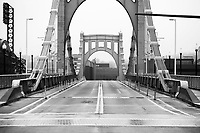 An empty Roberto Clemente bridge in downtown during rush hour on Monday March 23, 2020 in Pittsburgh, Pennsylvania. (Photo by Jared Wickerham/Pittsburgh City Paper)