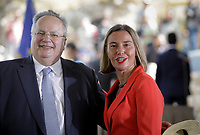 Pictured: (L-R) Greek Foreign minister Nikos Kotzias with Federica Mogherini. Sunday 17 June 2018<br /> Re: Greece and the Former Yugoslav Republic Of Macedonia (FYROM) have signed a deal that aims to settle a decades-long dispute over the country's name.<br /> Under the agreement, Greece's neighbour will be known as North Macedonia.<br /> Heated rows over Macedonia's name have been going on since the break-up of the former Yugoslavia, of which it was a part, and have held up Macedonia's entry to Nato and the EU.<br /> Greece has long argued that by using the name Macedonia, its neighbour was implying it had a claim on the northern Greek province also called Macedonia.<br /> The two countries' leaders, Mr Tsipras and his Macedonian counterpart Zoran Zaev announced the deal on Tuesday and have pressed ahead despite protests.<br /> The two countries' foreign ministers signed the deal on Lake Prespa on Greece's northern border on Sunday.<br /> The agreement still needs to be approved by both parliaments and by a referendum in Macedonia.