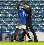 18.3.2021 Rangers v Slavia Prague: Steven Gerrard hugs a visibly upset Glen Kamara and walks him out of the stadium