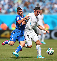 Marco Verratti of Italy and Cristian Rodriguez of Uruguay in action