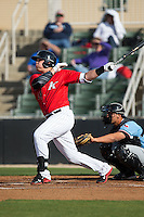 Corey Zangari (14) of the Kannapolis Intimidators follows through on his swing against the Hickory Crawdads at Kannapolis Intimidators Stadium on April 10, 2016 in Kannapolis, North Carolina.  The Intimidators defeated the Crawdads 10-3.  (Brian Westerholt/Four Seam Images)