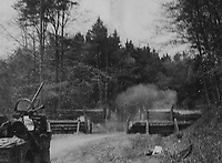 BNPS.co.uk (01202) 558833. <br /> Pic: Bosleys/BNPS<br /> <br /> Pictured: SAS troops blow up a road block in Germany.  <br /> <br /> Never before seen photos taken by a fishmonger turned SAS hero behind enemy lines in World War Two have come to light 76 years on.<br /> <br /> Sergeant Samuel Rushworth, of the 2nd Special Air Service, was dropped into occupied France two days before D-Day in June 1944.<br /> <br /> They were tasked with disrupting German reinforcements dispatched to Normandy following the Allied landings.